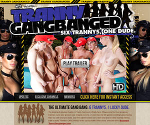 Tranny Gang Banged! One Guy Group-Fucked by an Orgy of Hot Shemales and Sexy Transsexuals!